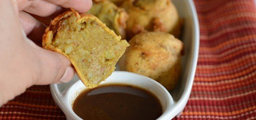 Alu Bonda dipping in sauce