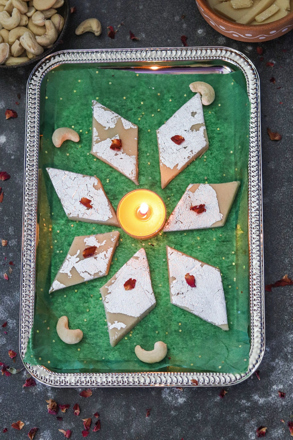 Kaju Katli in a plate with diya in center