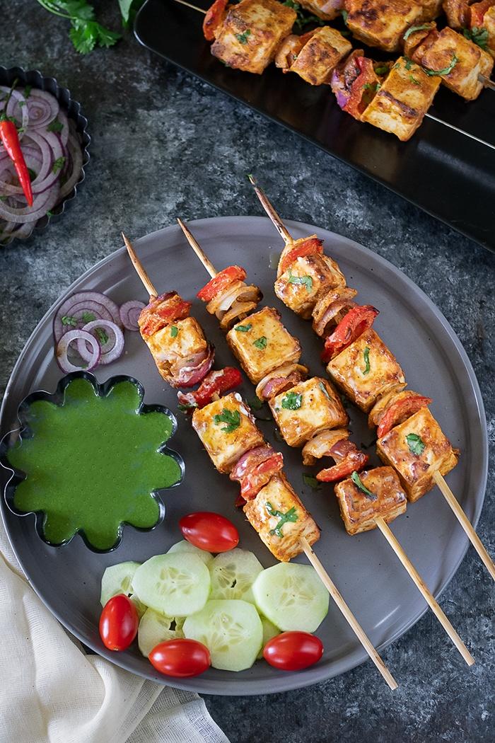 Achari paneer tikka with cucumber and cherry tomatoes