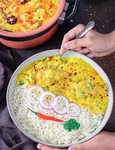 Punjabi Kadhi pakoda on a plate with red chili