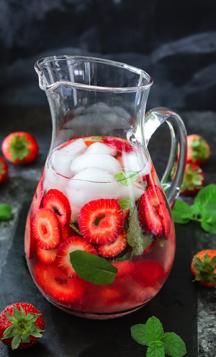 Strawberry flavored water in a pitcher