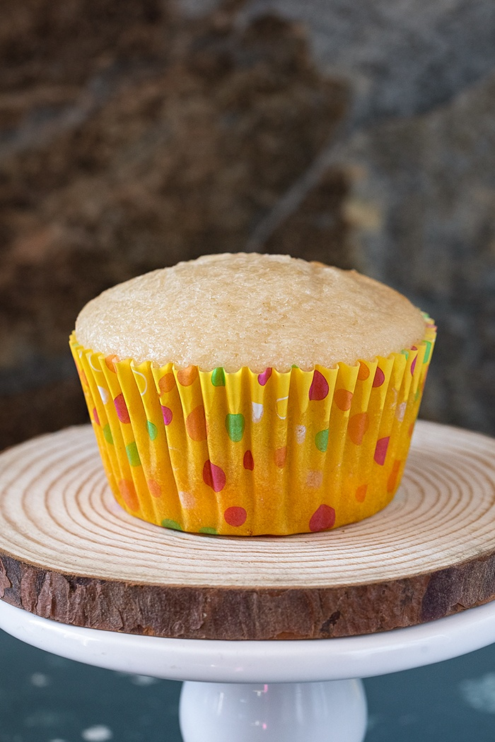 Perfectly moist and fluffy Eggless vanilla cupcakes on a stand