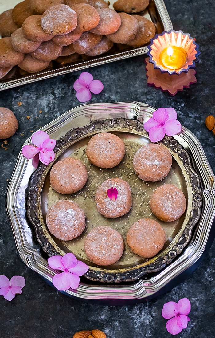 Mathura ke Pede in a plate with pink flowers