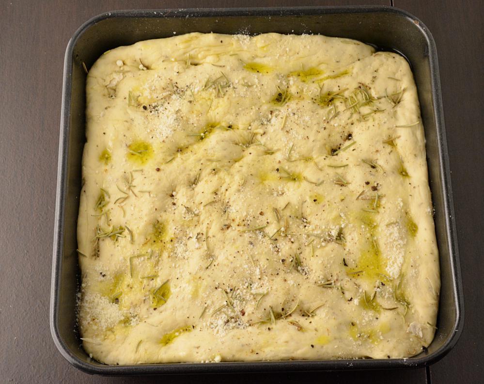 Focaccia bread drizzled with oil.