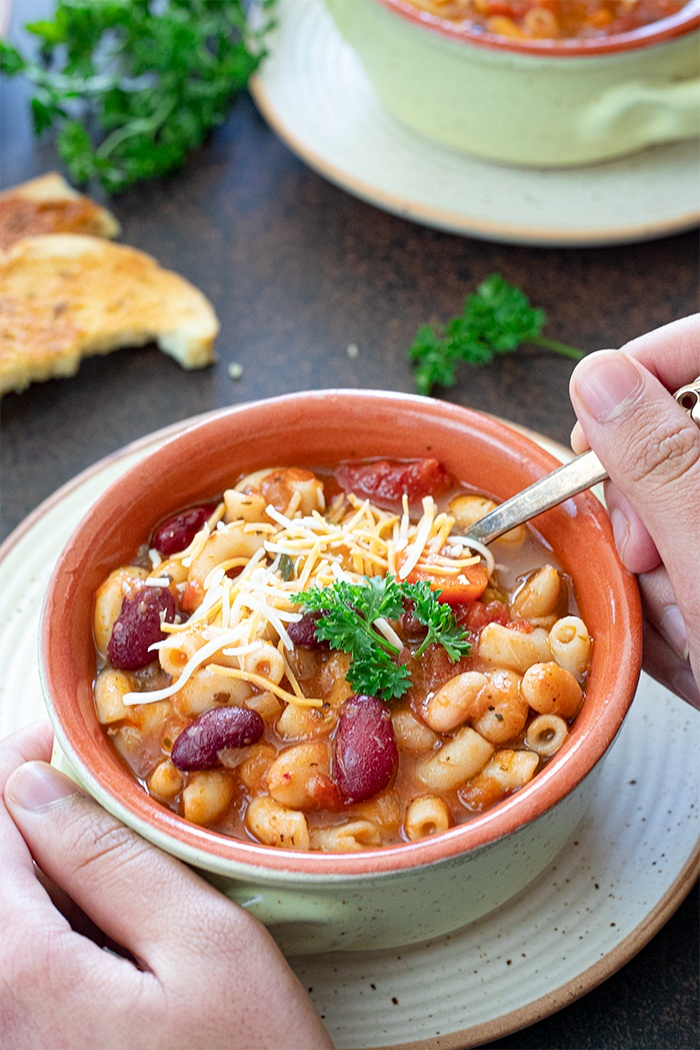 Slow cooker Minestrone soup with a spoon