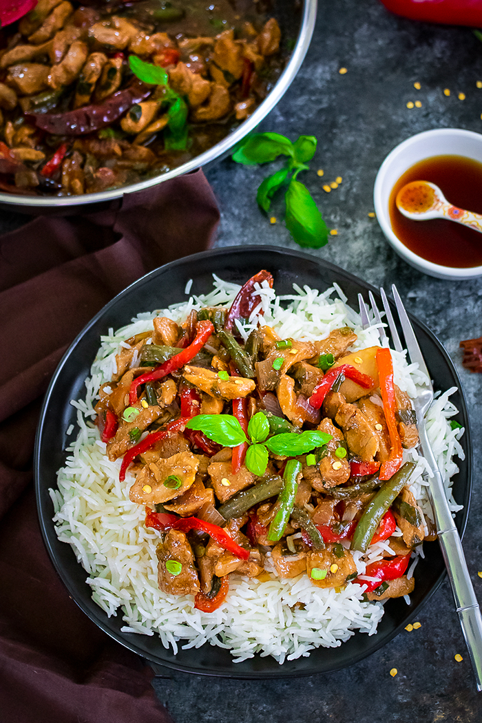 Thai Basil Chicken in a plate over bed of rice