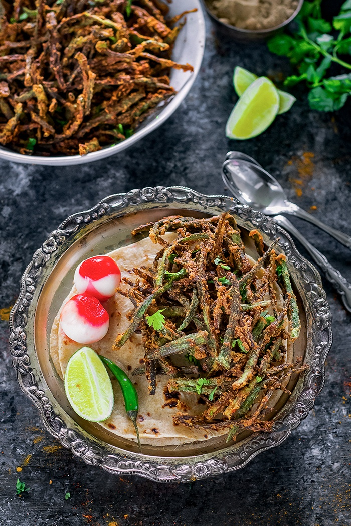Kurkuri bhindi on a plate with vinegar onions