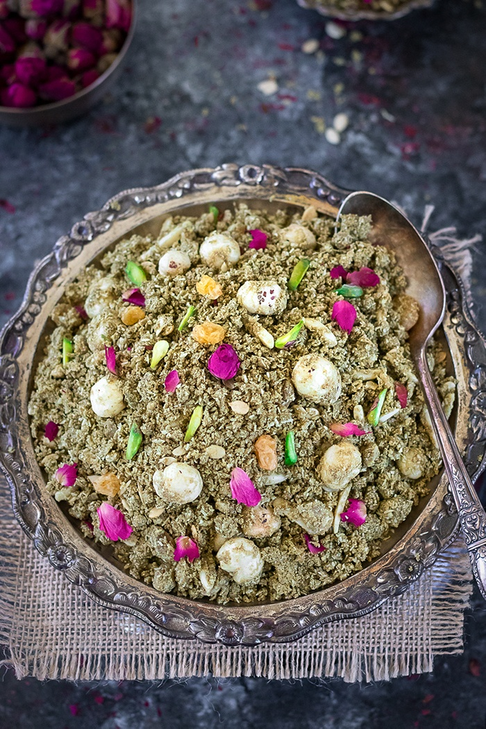 Janmashtami Dhaniya Panjiri  in a plate garnished with rose petals and pistachios