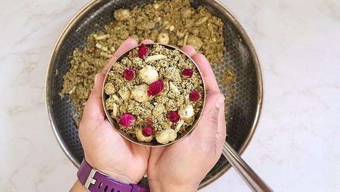 Dhaniya Panjiri in a bowl garnished with rose petals