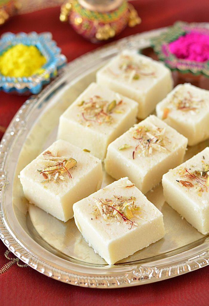 Burfi cubes arranged in a tray