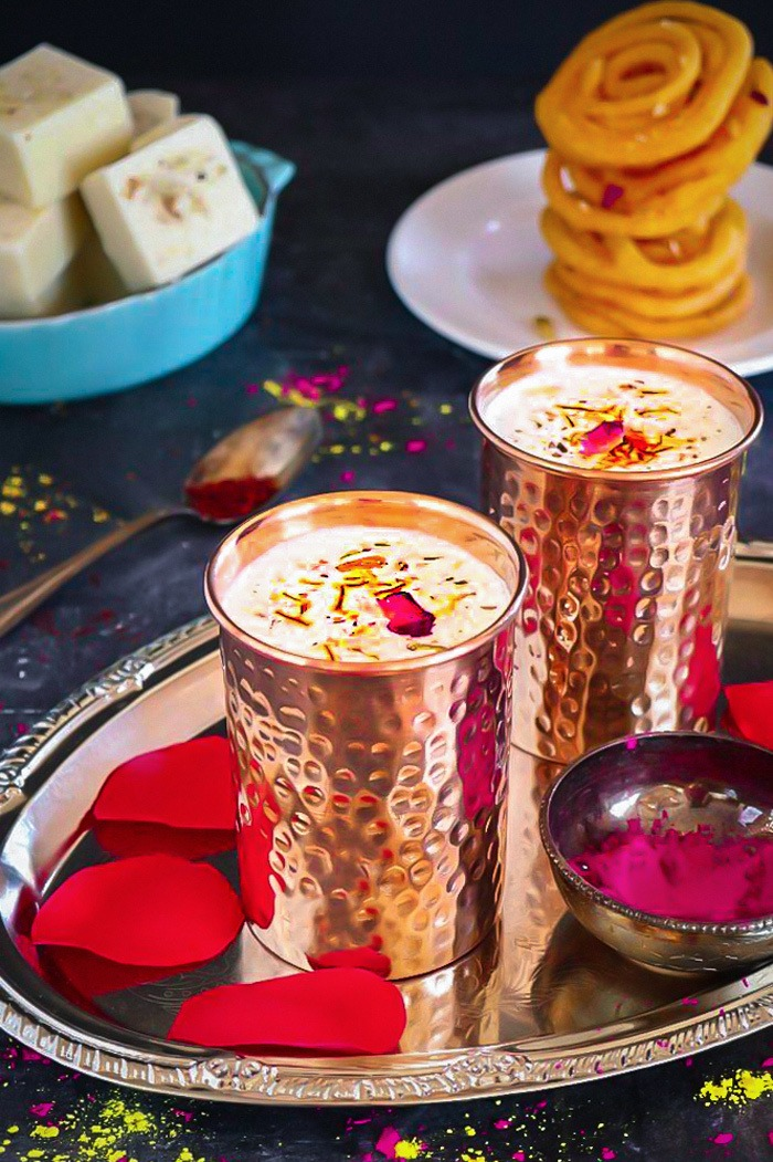 Thandai recipe in a tray with rose petals