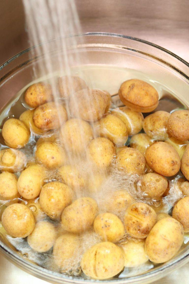 Oven Roasted Potatoes being washed