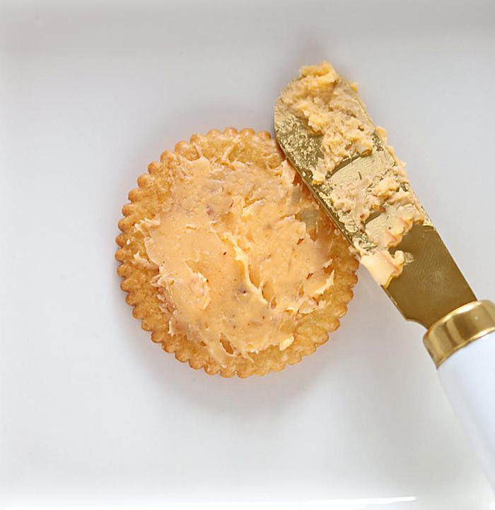 Top ritz cracker with hummus