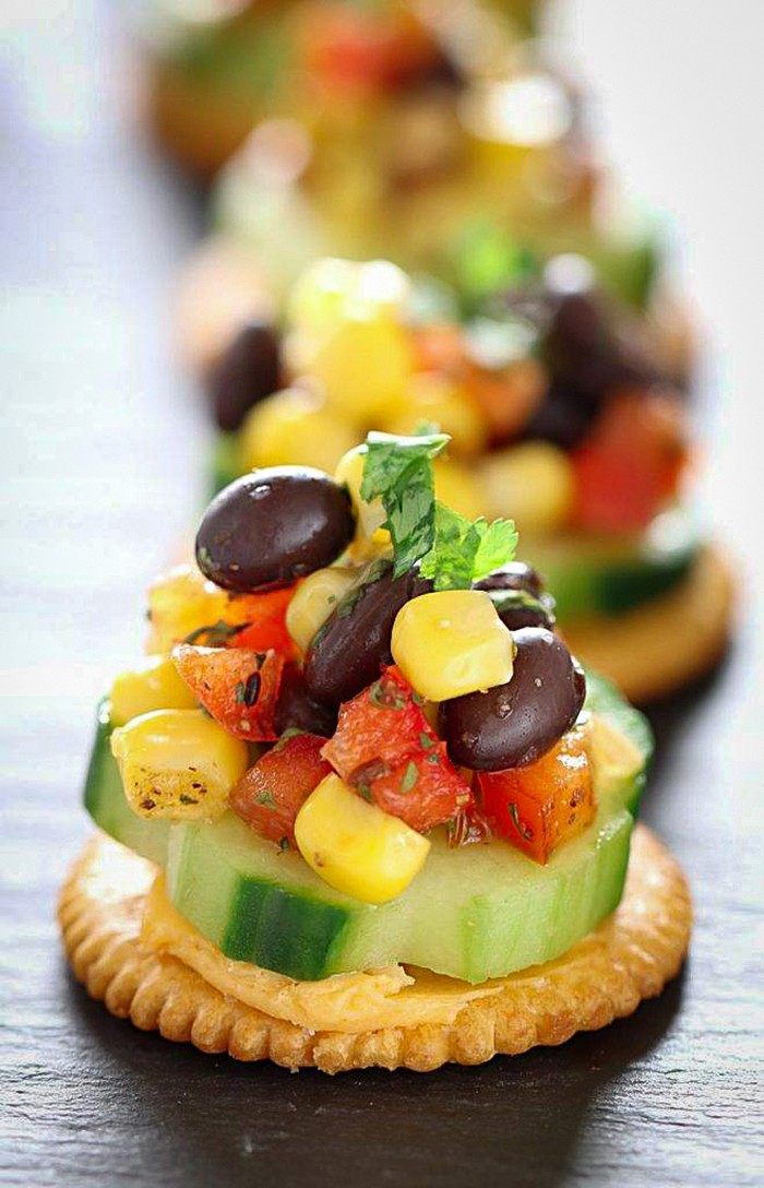 Ritz crackers topped with corn and black bean salsa