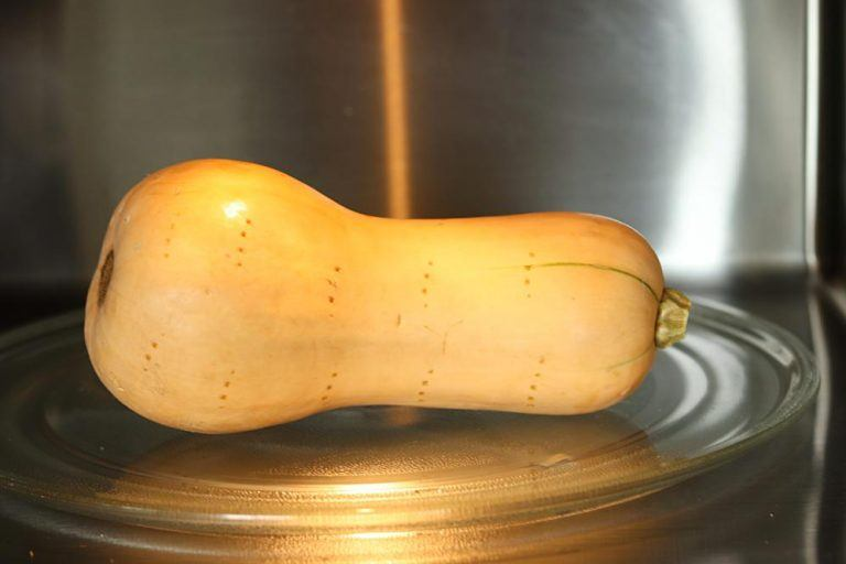 Poke hole in butternut squash and warm in the microwave