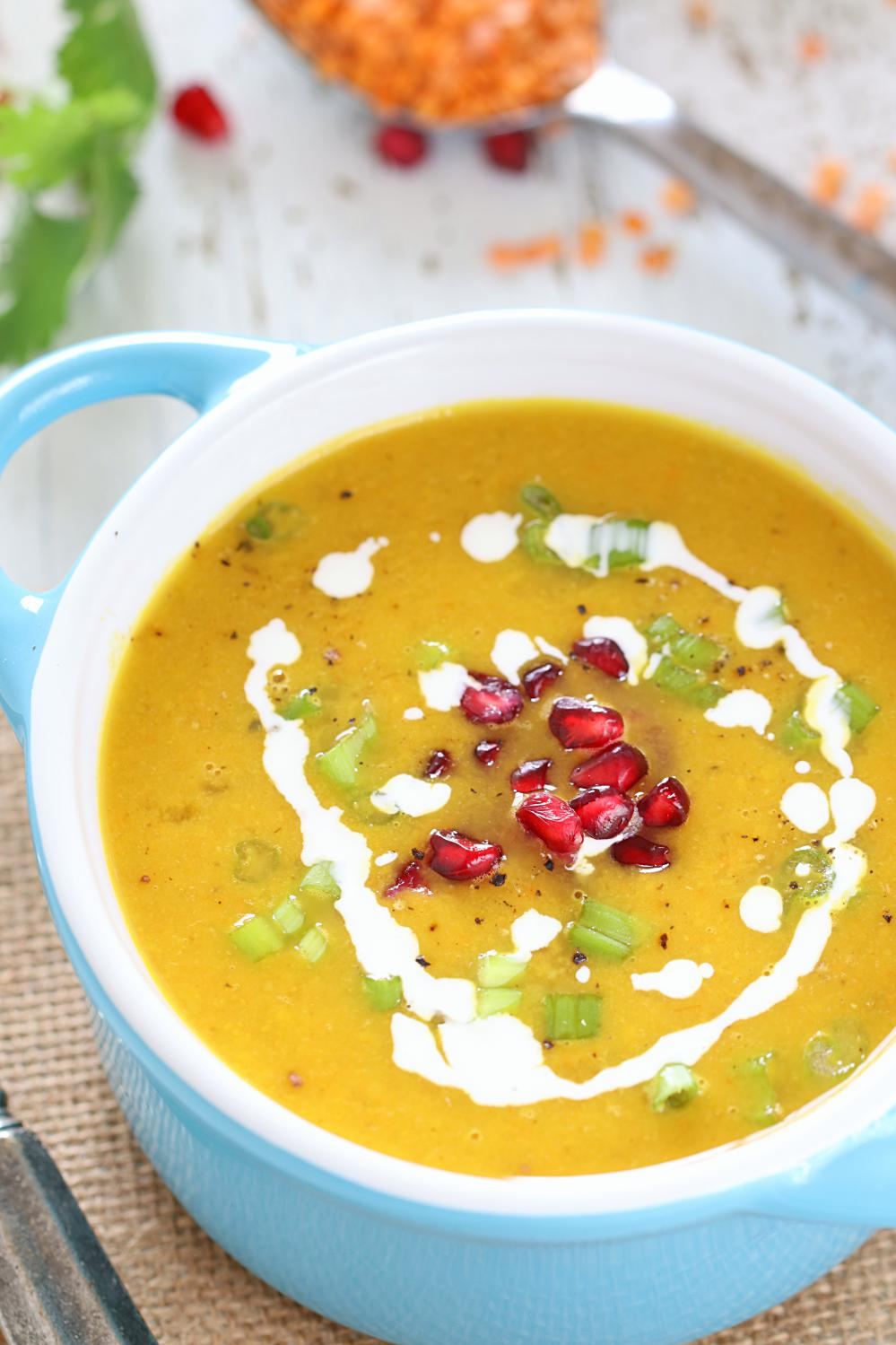 Butternut Squash and Lentil Soup garnished with pomegranate seeds