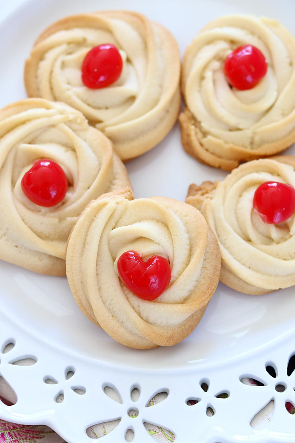 Eggless Swirl Shortbread Cookies decorated with cherries