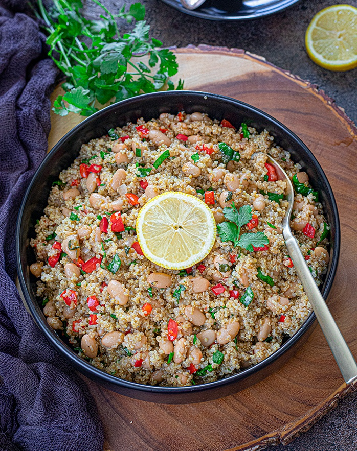 White bean coconut quinoa in a bowl with lemon