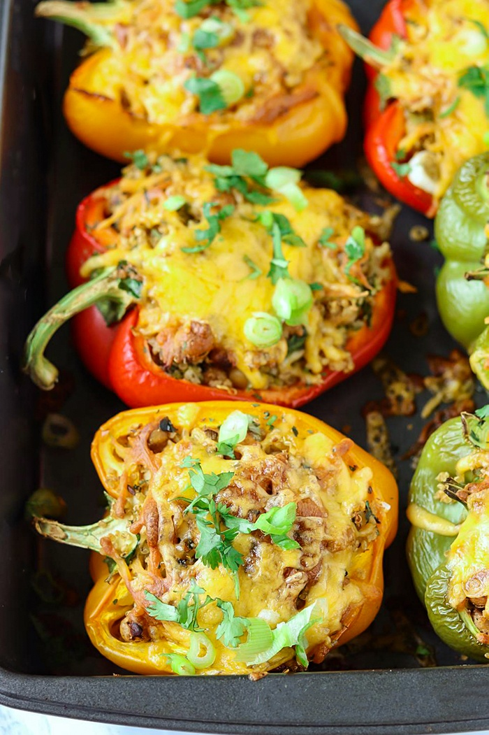 Cheese stuffed bell peppers in a baking tray