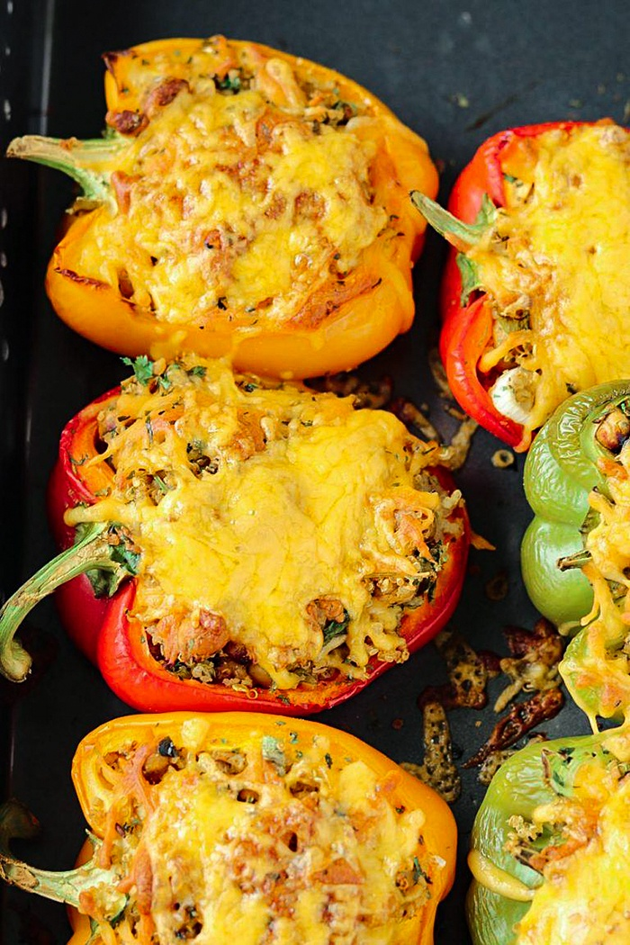 Cheesy and gooey Roasted chickpeas and quinoa stuffed bell peppers