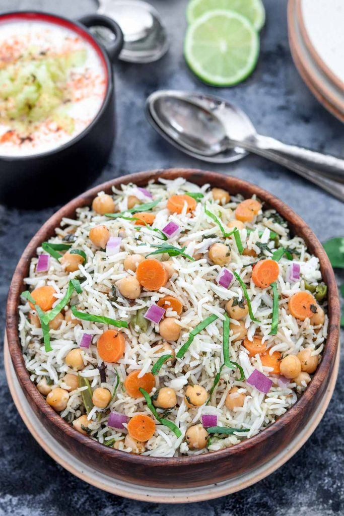 Instant Pot Chickpea and spinach Pulao with raita and two spoons - Ruchiskitchen