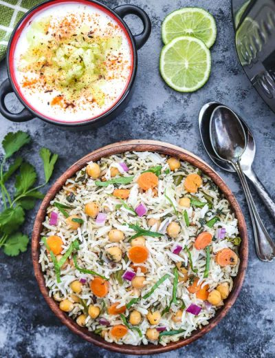 Instant Pot Chickpea and spinach Pulao with raita and lemon slice - Ruchiskitchen