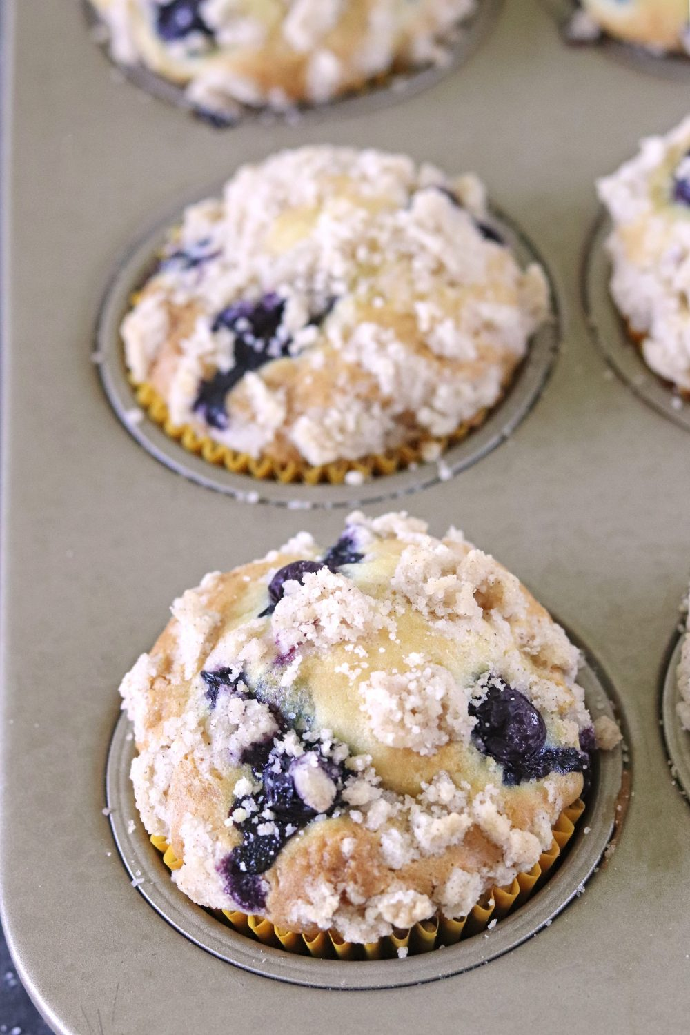 Baked Blueberry Muffins With Streusel Crumb Topping in tray