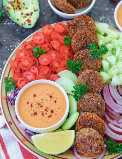 Vegan Falafel Salad with cucumber, lettuce, and tomatoes