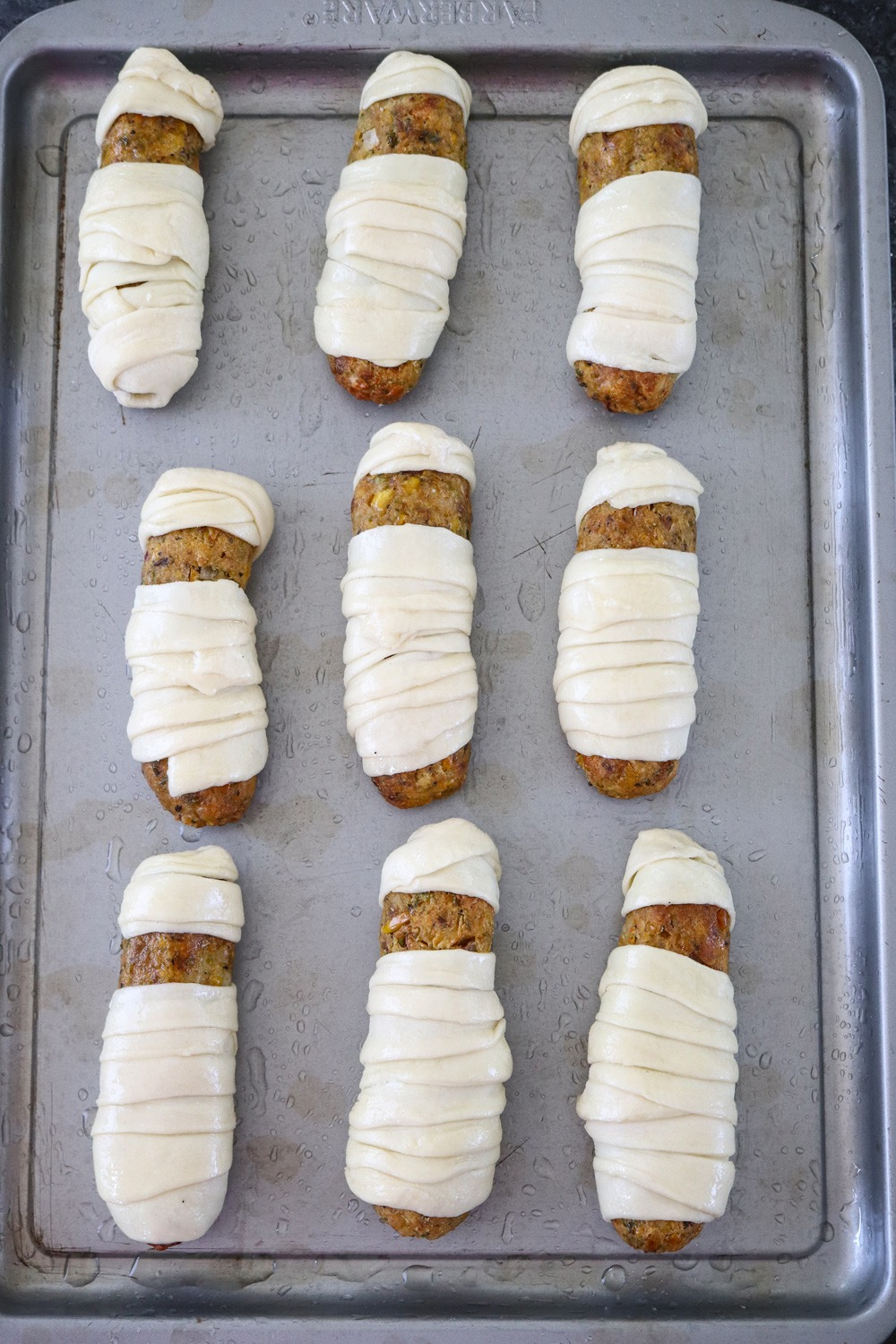 Croquettes ready for baking on a tray