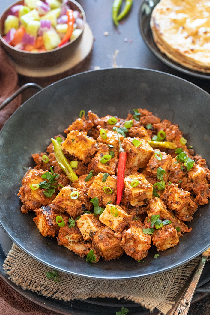 Tawa paneer in a bowl garnished with scallions