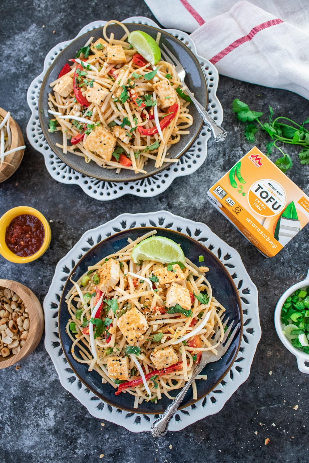 Vegan Pad Thai noodles with peanuts, chili sauce, and scallions