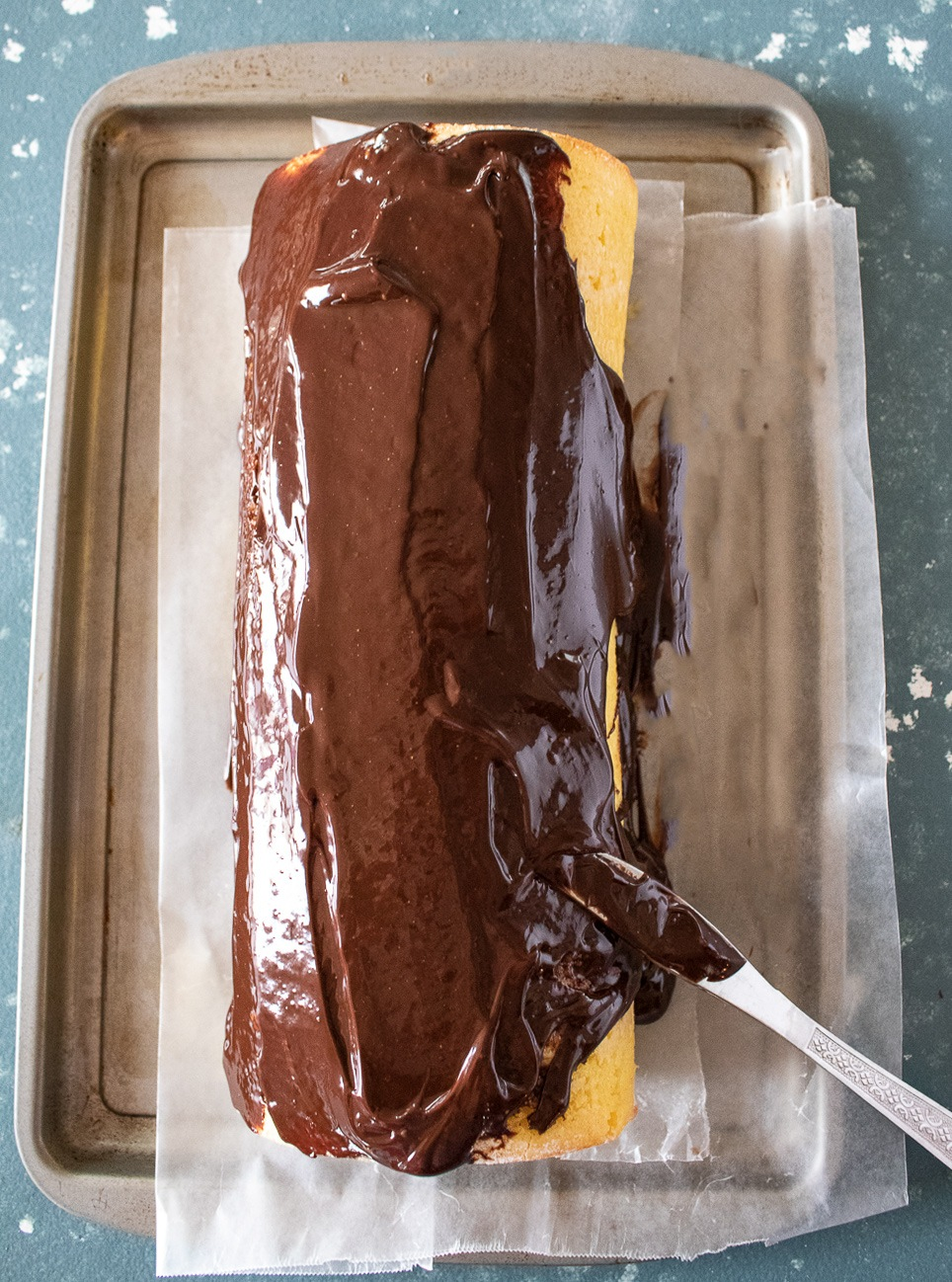 Apply Chocolate Ganache on log cake