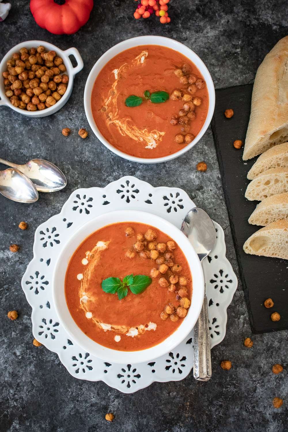 Instant Pot Roasted Red Pepper and Tomato Bisque with roasted chickpeas and basil leaves
