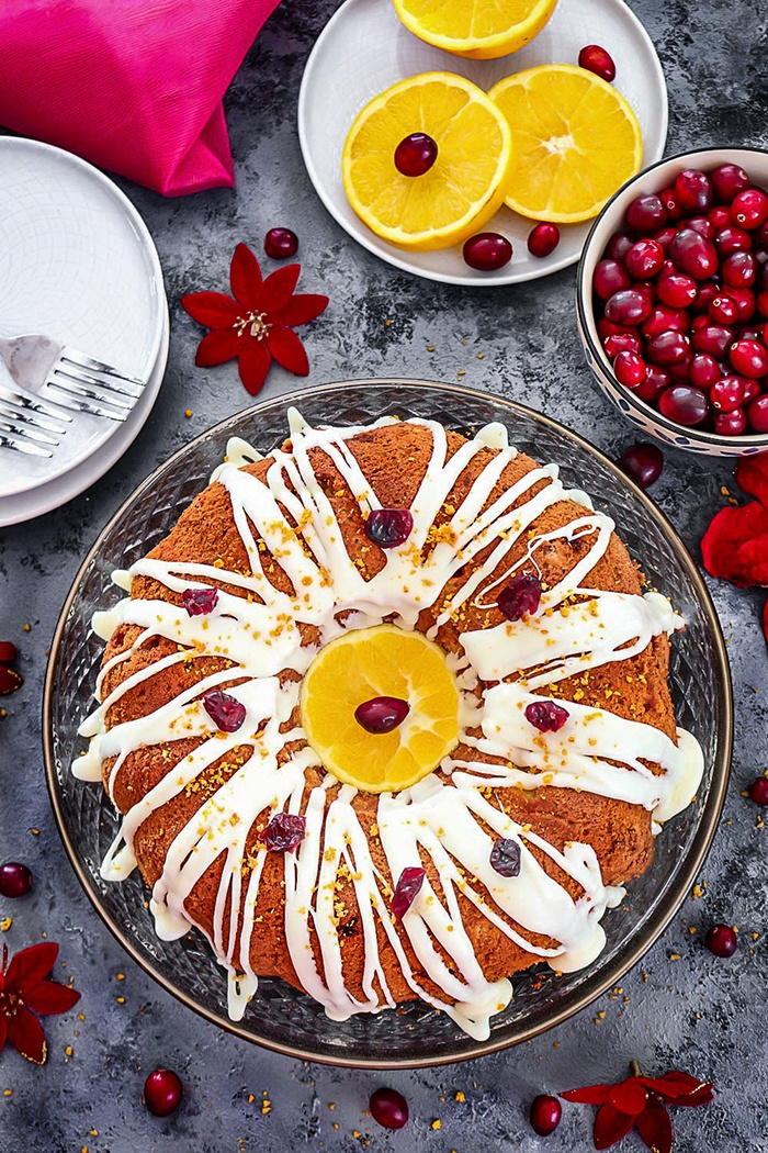 White Chocolate Cranberry Bundt Cake drizzled with chocolate