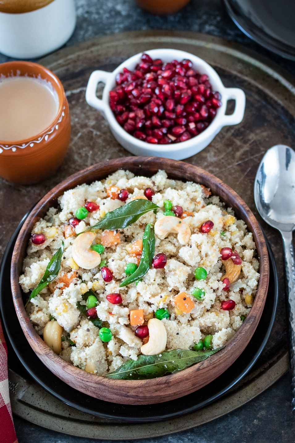 Upma with tea and pomegranate