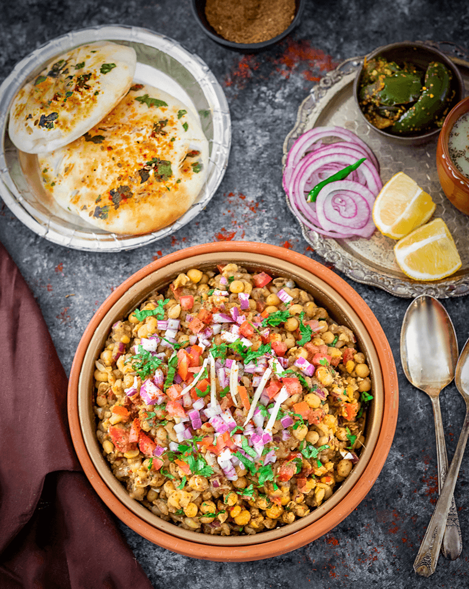 Matar kulcha recipe with pickle and lemon on the side