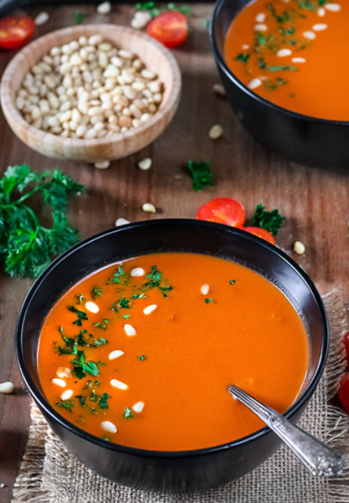 Instant Pot Roasted Bell Pepper And Tomato Bisque garnished with pinenuts