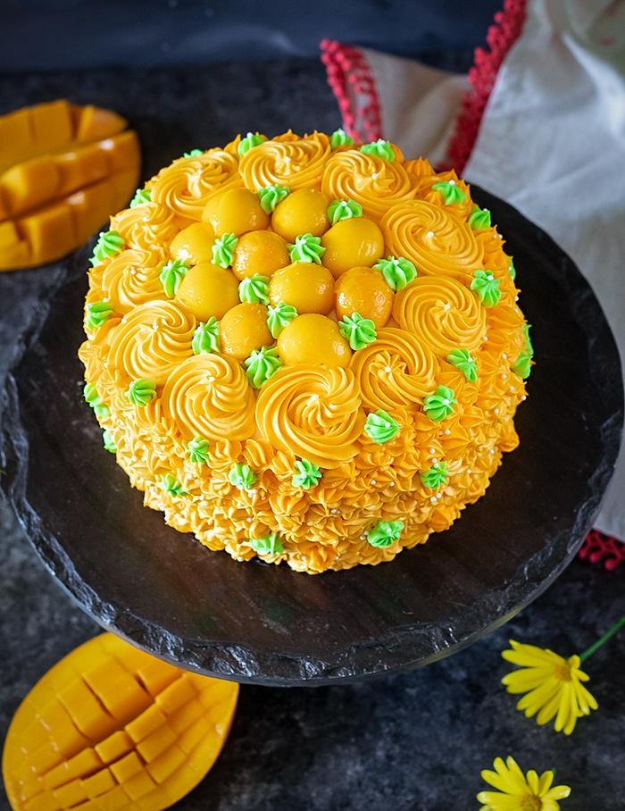 Decorated eggless mango cake