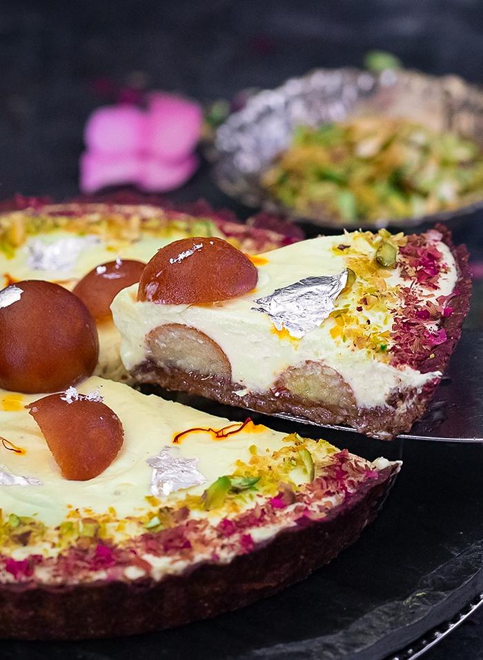 Cut slice of Gulab Jamun tart