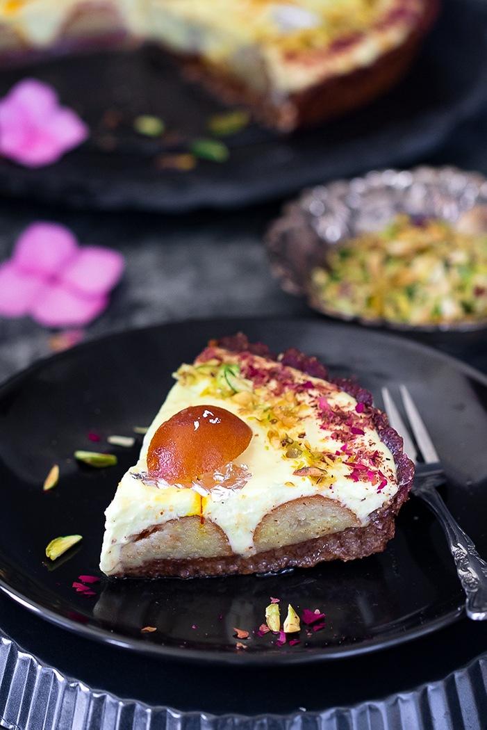 Cut slice of Gulab Jamun Yogurt Tart on a plate with fork