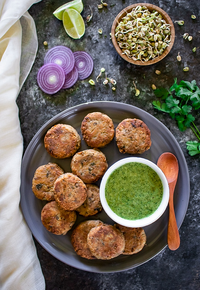 Sprouted Moong dal Cutlets with green chutney and spoon