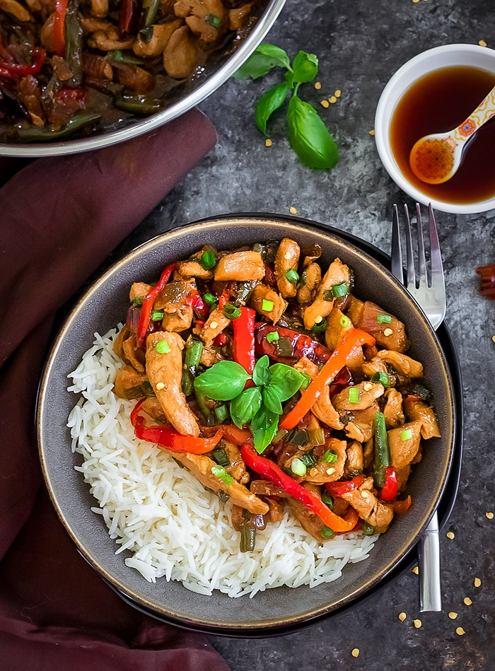 Thai Basil Chicken in a bowl with rice