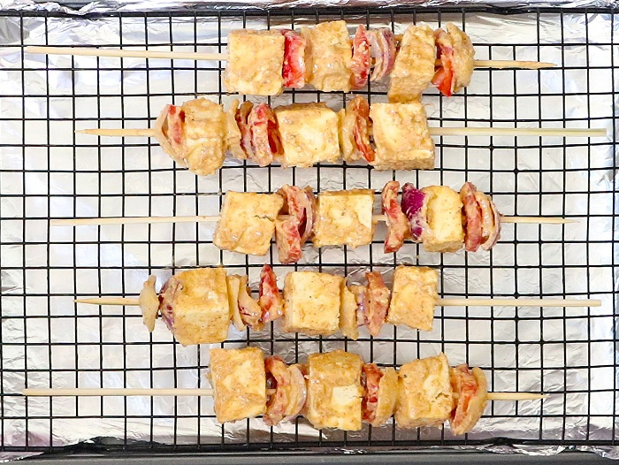Arrange skewers on a baking tray