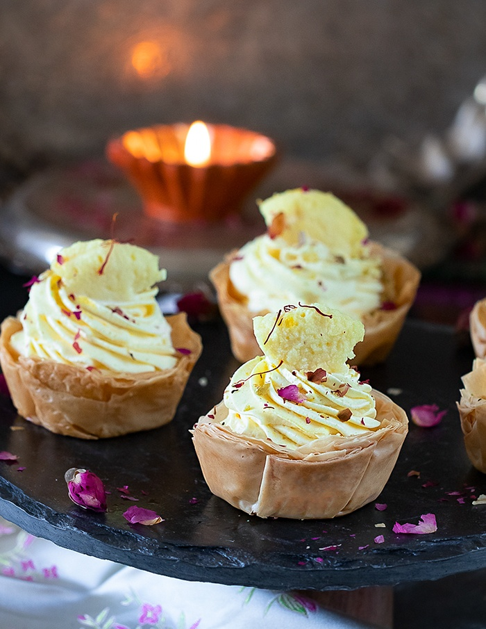 Rasmalai Mousse Phyllo Cups on a black tray