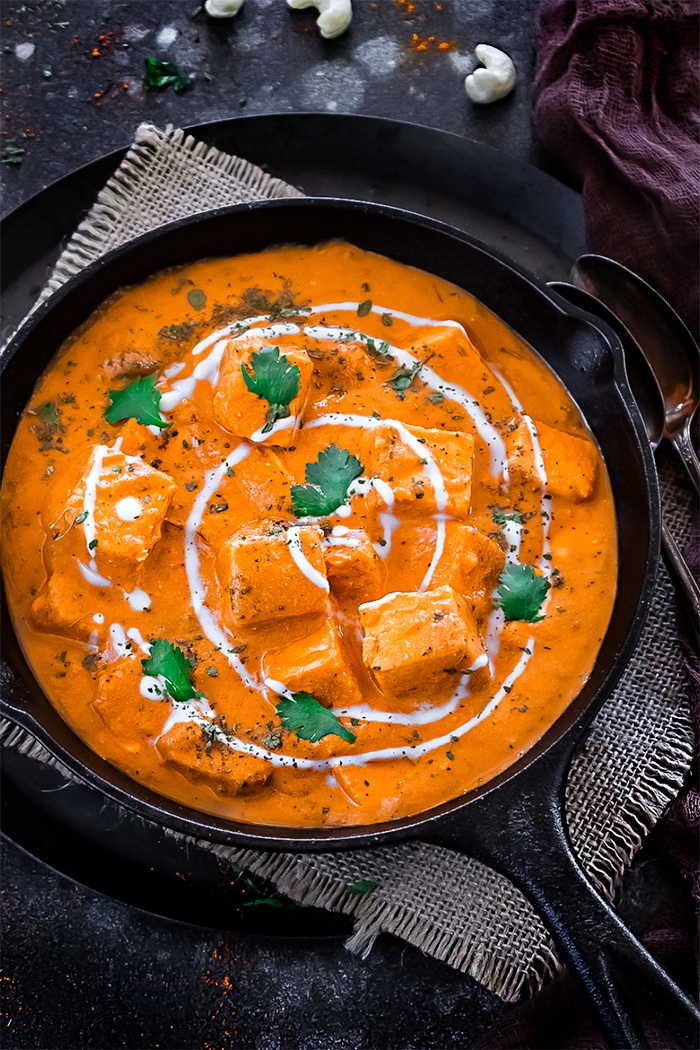 Paneer Makhani served garnished with cilantro