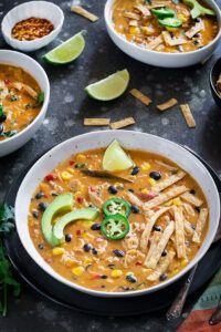 Instant Pot Creamy Chicken Tortilla Soup in a bowl garnished with avocados