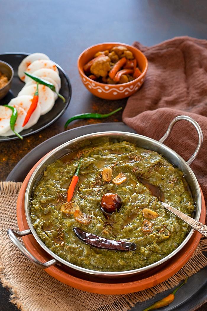 Sarson ka saag topped with garlic tempering