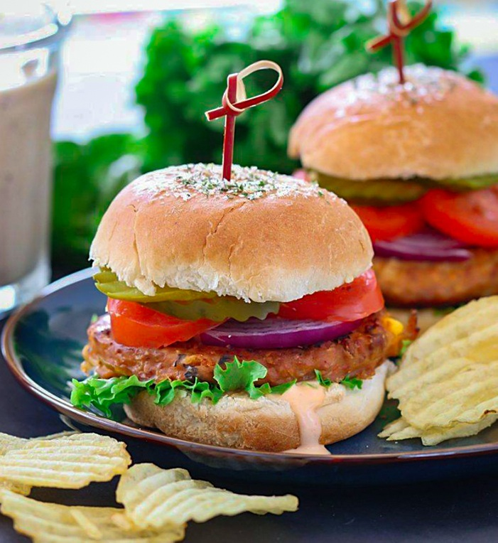 Layered Sun-dried tomato chickpea burger on a plate