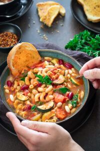 Instant Pot Minestrone soup with a slice of bread