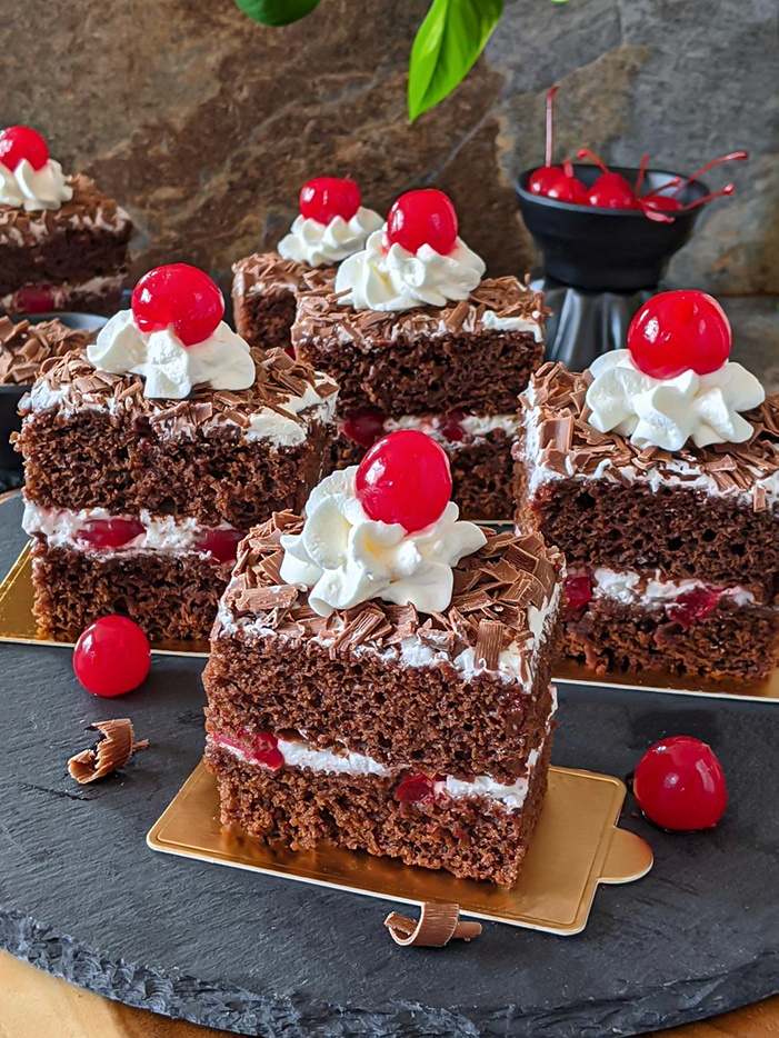 Eggless Black forest pastry decorated with cherries